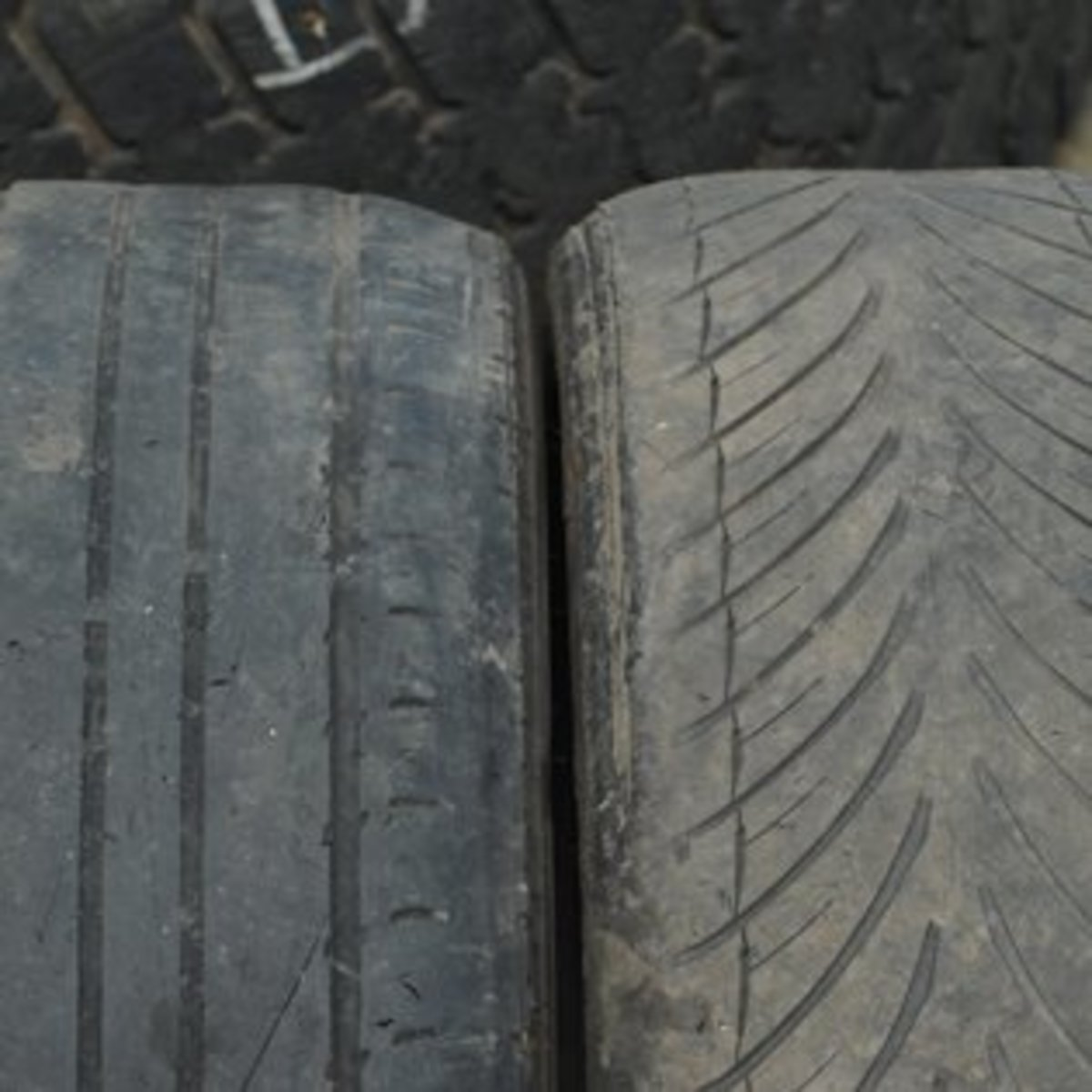 The dealer should replace any worn tyres of reduce the price of the car