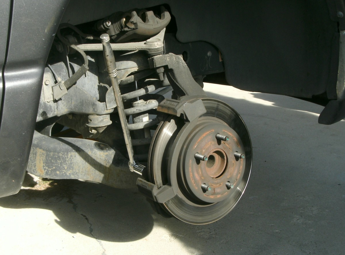 Caliper removed and placed above axel on supporting A frame