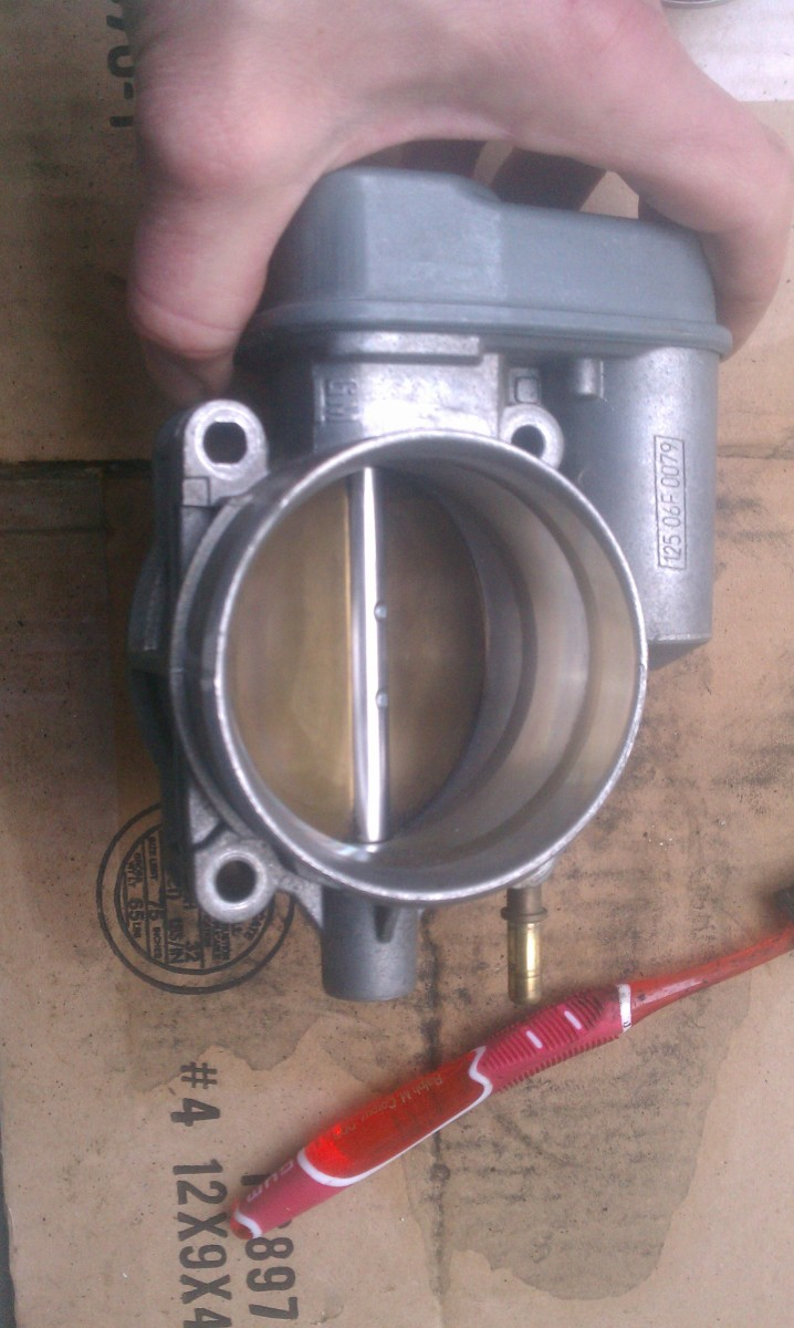 The throttle body from the Chevy all nice and clean.