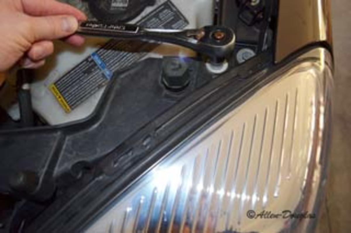 Remove the headlight bolts using a socket wrench