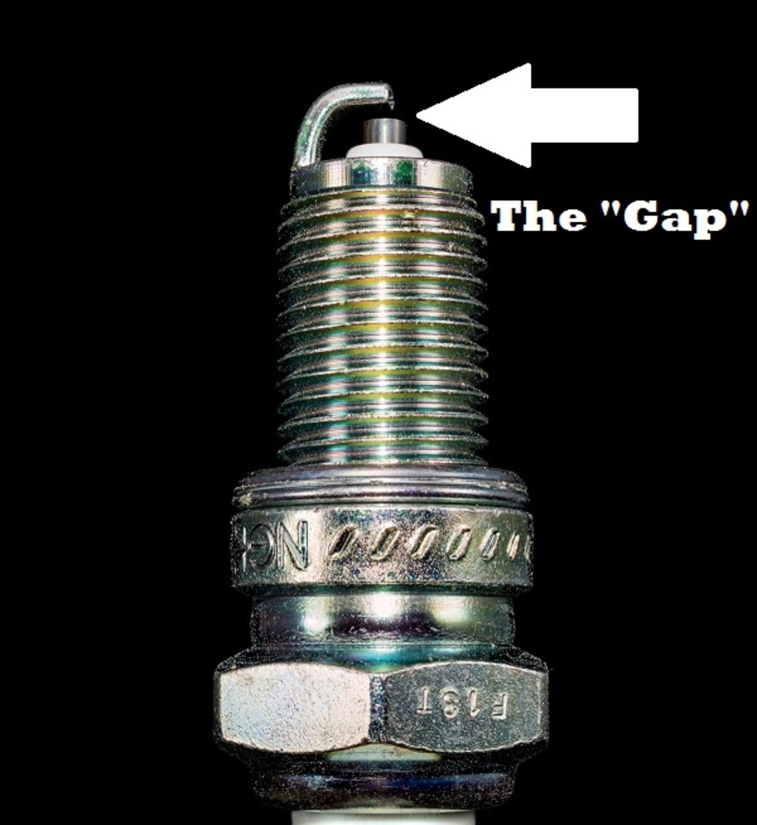 Set the gap of the spark plug by bending the right angled metal piece at the end to the appropriate distance using a gapper tool.