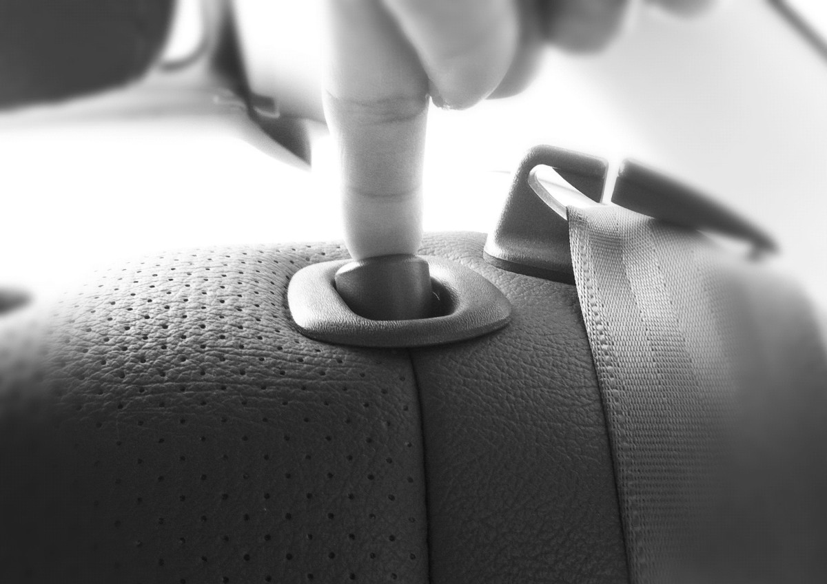 Push the button next to the seat belts on both rear seats and pull down the seat backs.