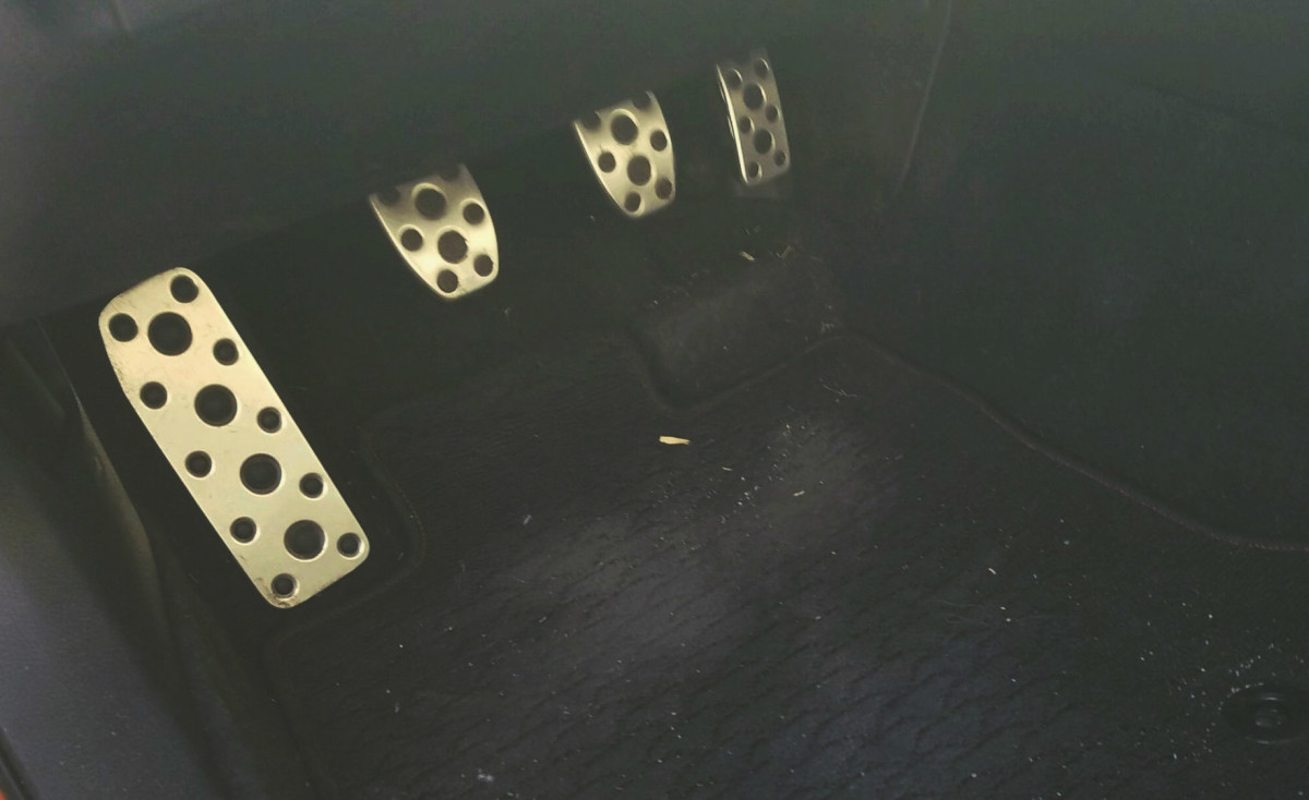 The far left is not a pedal, it's a resting place for your foot while driving. The clutch pedal is second from the left. The brake is next and the gas is on the far right.