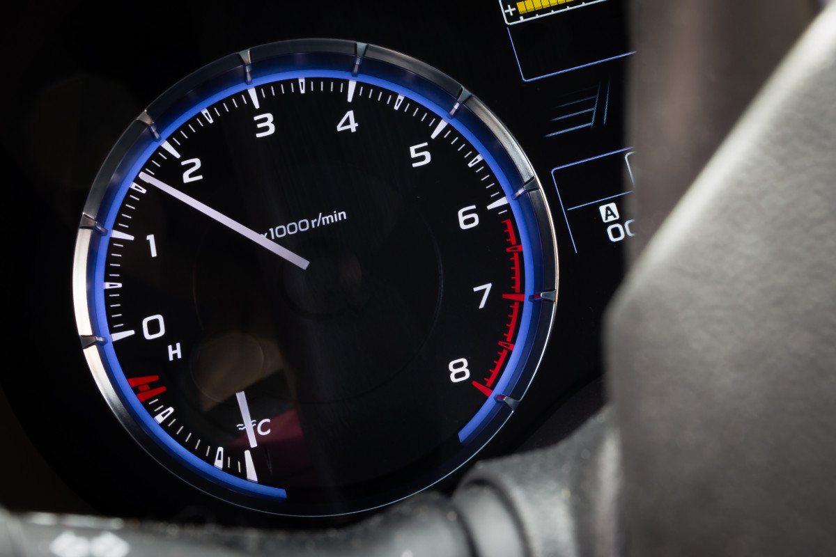 Release the clutch until you feel the car start to roll a bit. Press down on the gas until the needle on your tachometer is between 1000 and 2000 rpm.