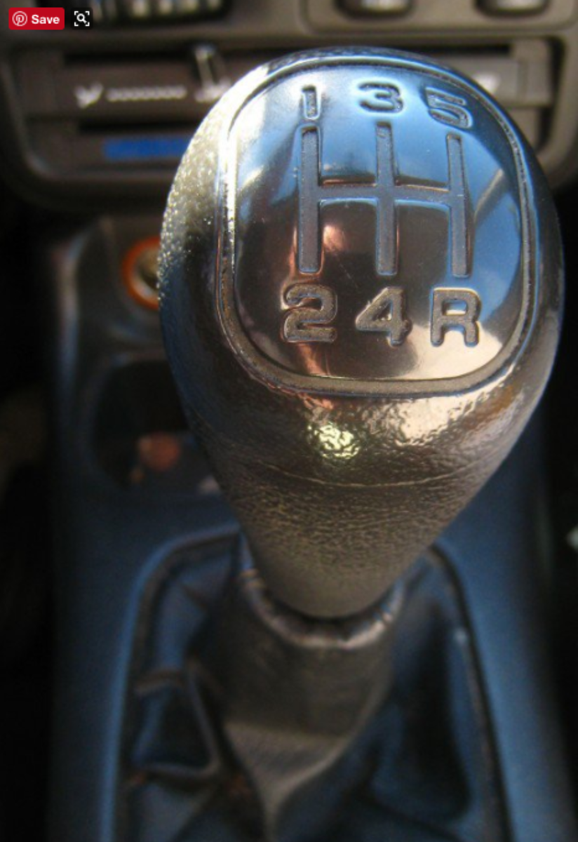 "With the engine off, move the stick around. All gear arrangements are in an ""H"" shape, but the location of reverse varies. On this stick, reverse is to the right and down. On other stick shifts reverse is to the left and up."