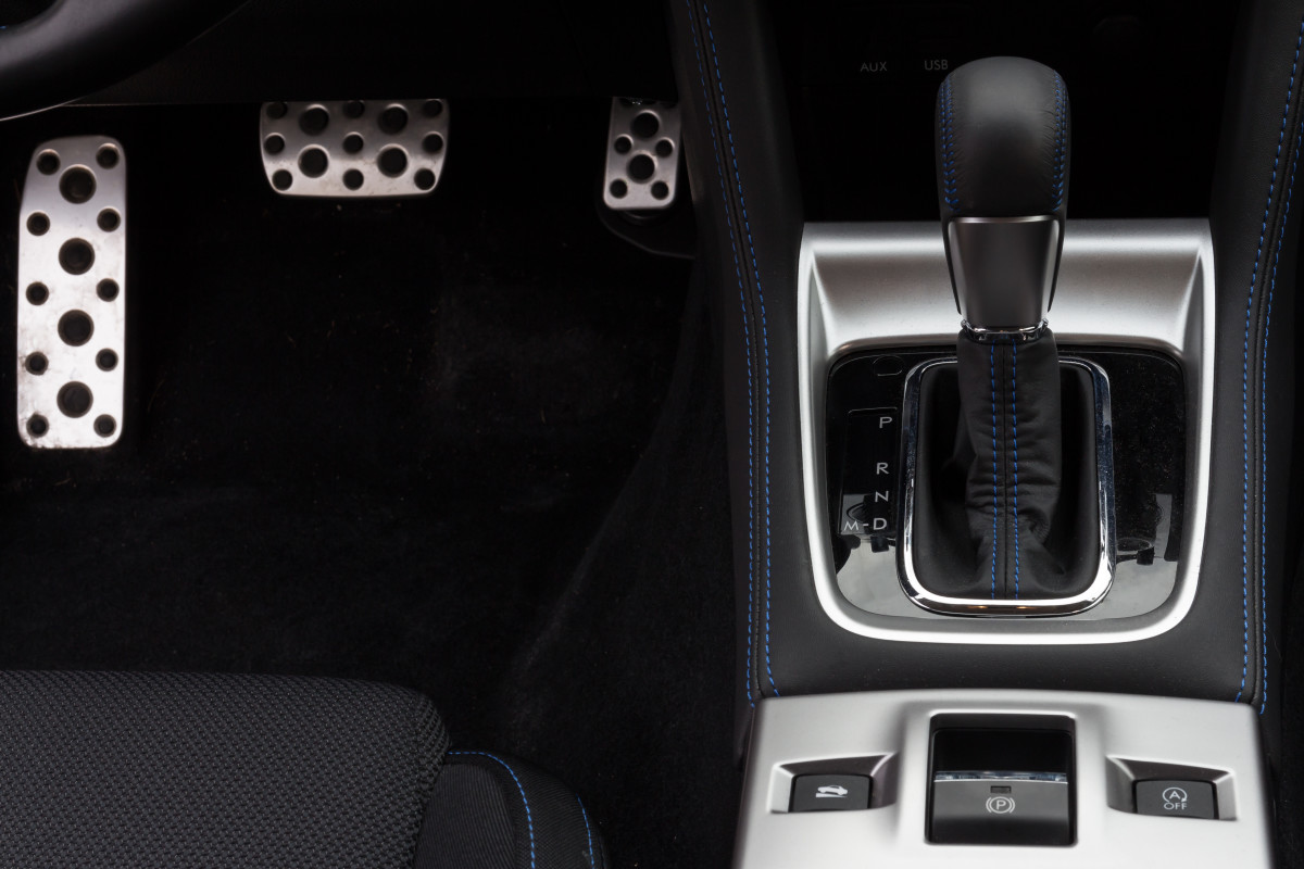 The silver pad on the left of this automatic transmission car is where you can rest your left foot. The brake is in the middle and the accelerator or gas pedal is on the far right.