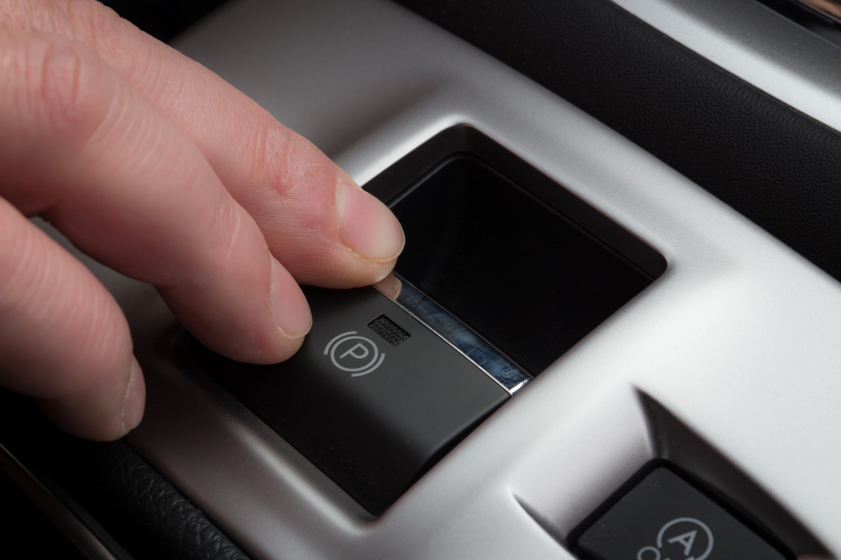 Some cars have a push-button emergency, or parking, brake control (as above). Many others have a lever with release button at the end.