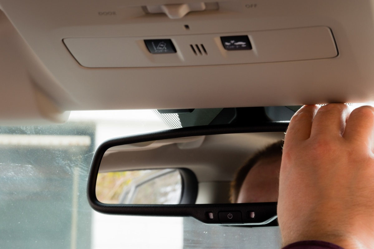 Adjust your side and rear-view mirrors so you can see what's behind you and to the side. Make sure you are in a secluded area and that you have enough space in front of you so you can move at different speeds without running into something.