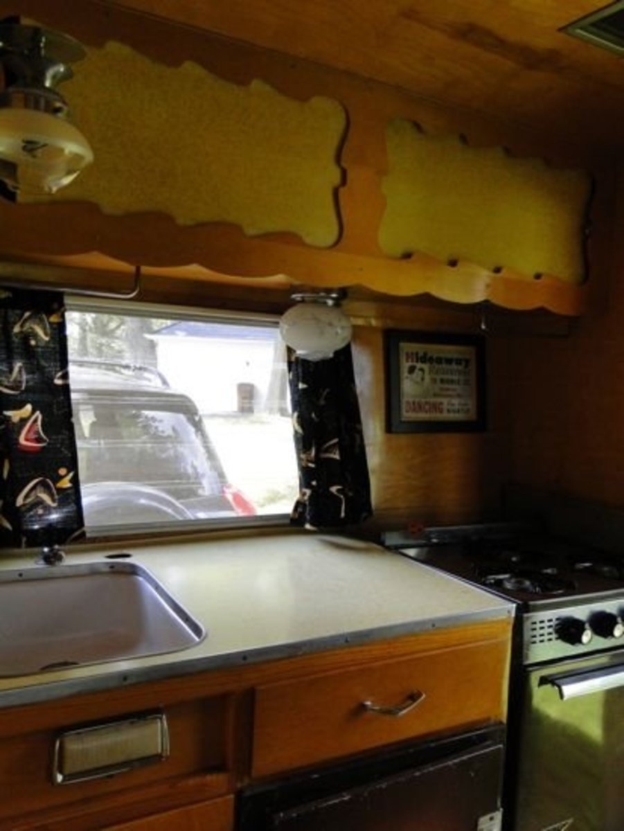 Cute, Compact & convenient. The Shasta Compact's kitchen packs a lot in a tiny space. Stove, oven, sink, ice box, 3 drawers and cabinets over and under the sink!