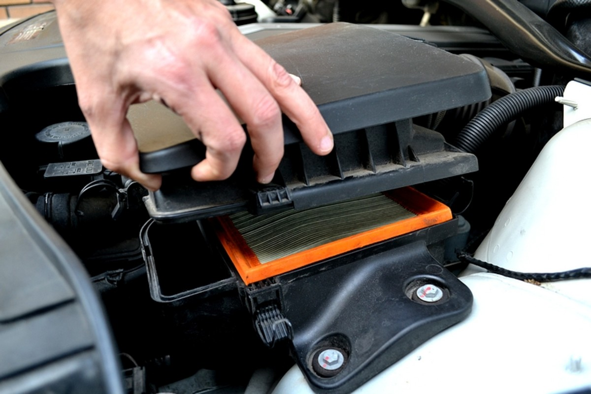 With the clips unlatched, lift the corner of the airbox to reveal the air filter.  You can lift the filter up and slide it out.