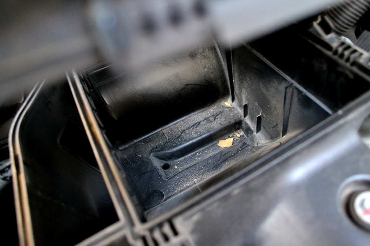 Looking inside the air box with the filter removed.  You can see the accumulated dirt.  It's a good idea to take a rag and wipe out the inside of the air box so that your new filter doesn't have to eat that dirt.
