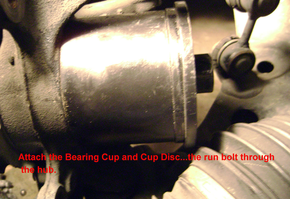 R.  Attach the bearing cup and cup disc, then run bolt through hub