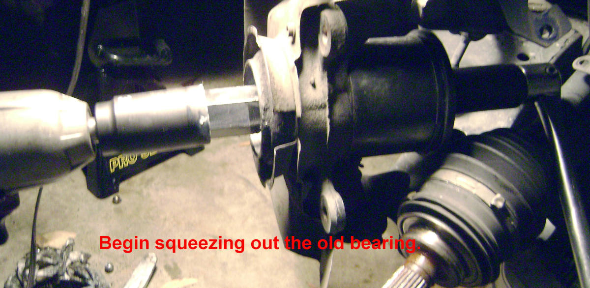 S.  Begin squeezing out the old bearing