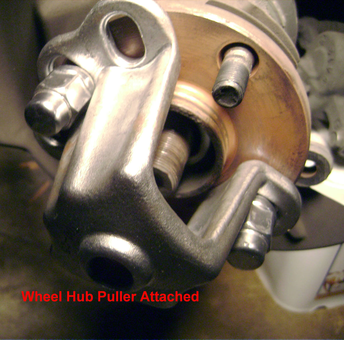 J.  Hub puller attached to hub