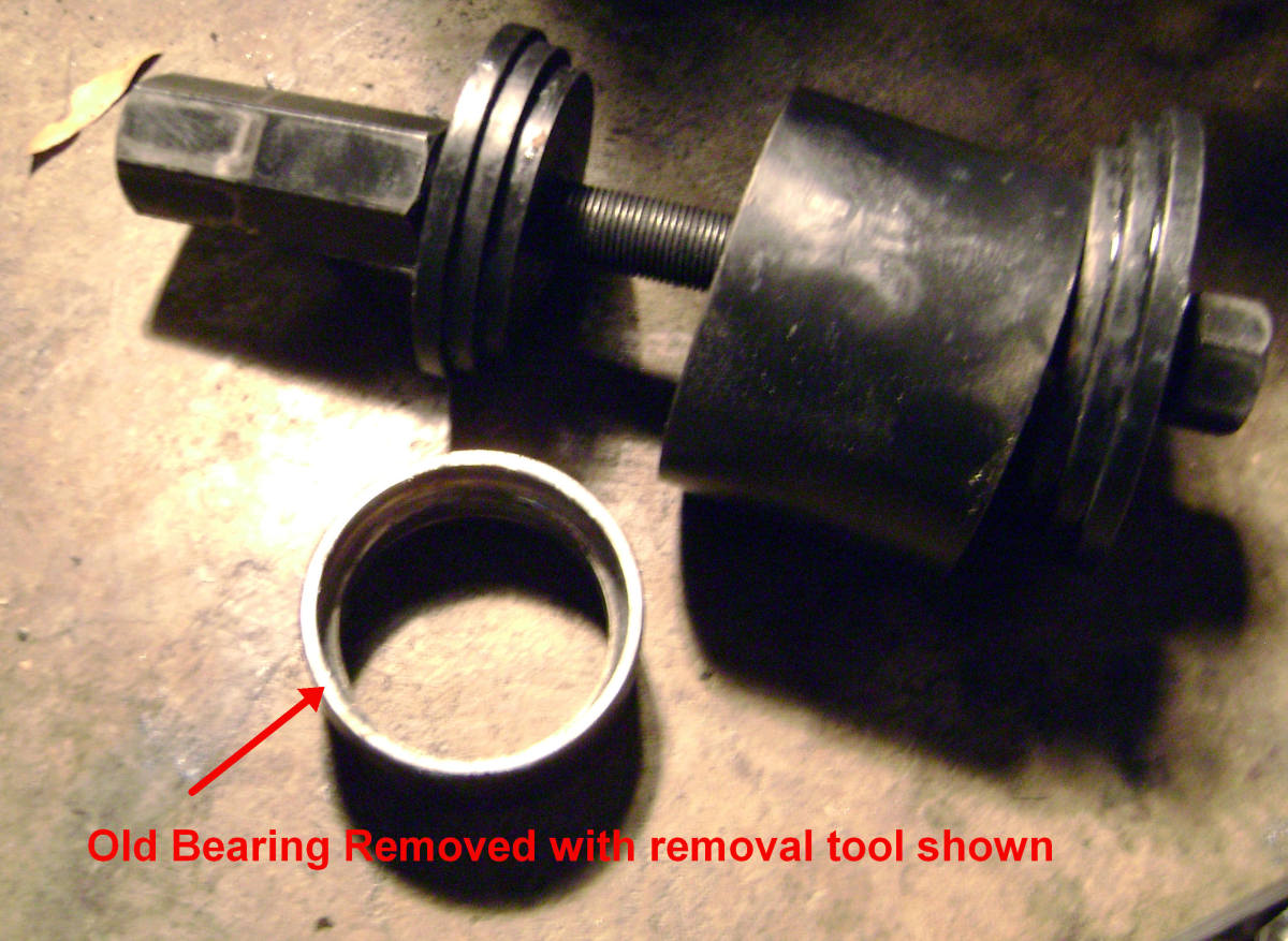 T.  Old bearing, with removal tool