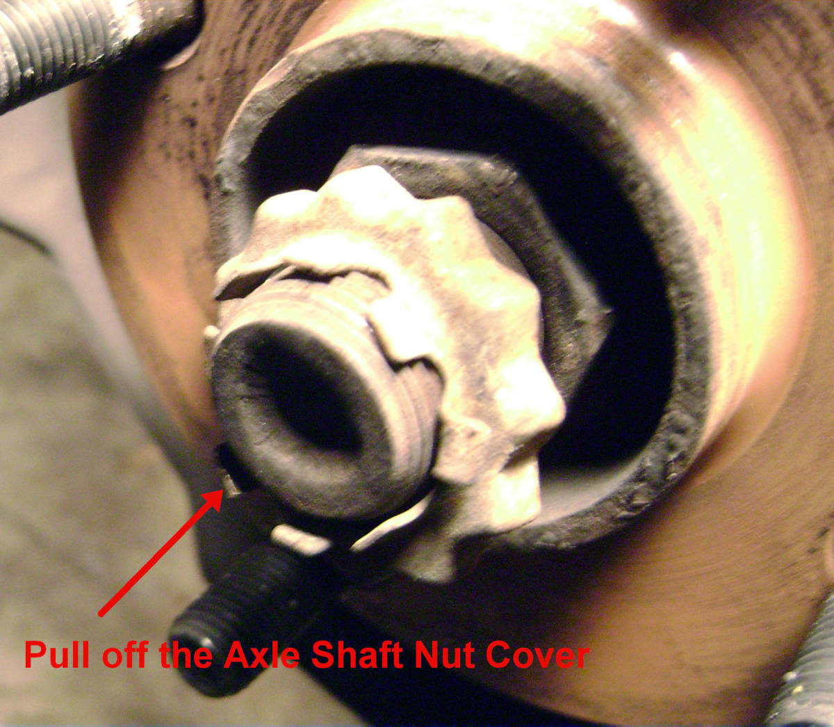 F.  Pull off axle shaft nut cover