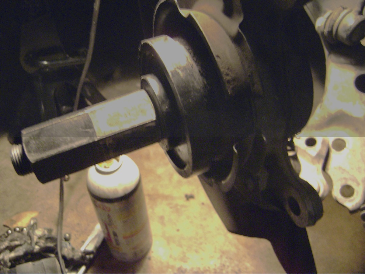 V.  Set up the wheel bearing tool to squeeze in the old bearing