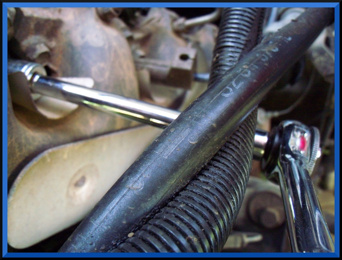 ...use an extension if necessary to seat the socket on the spark plug.