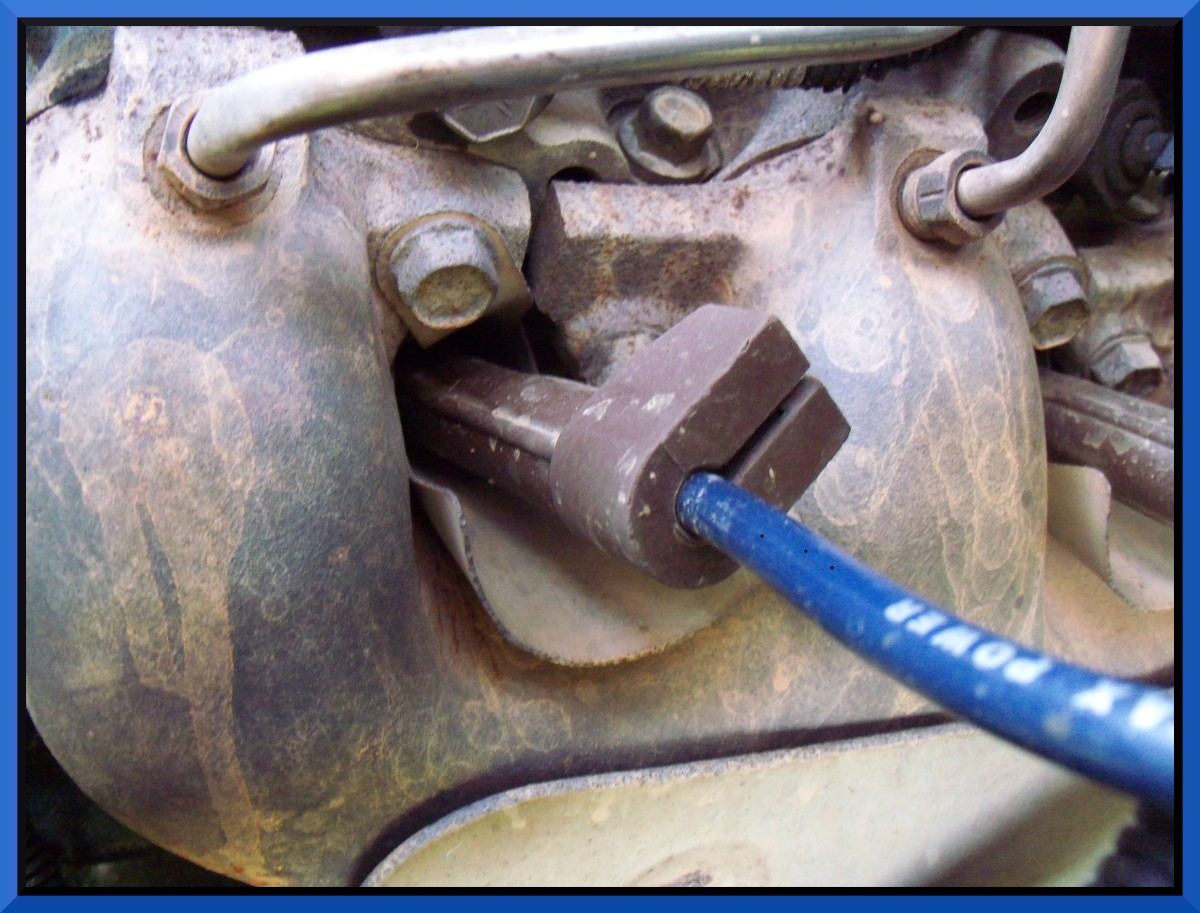 Remove the boot to access the spark plug...