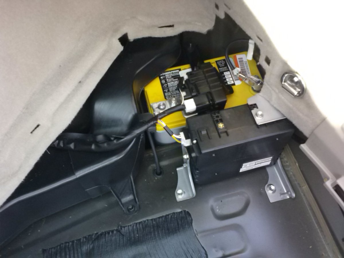 The Prius' battery lives here, hidden under a panel in the rear, passenger-side corner of the hatch.