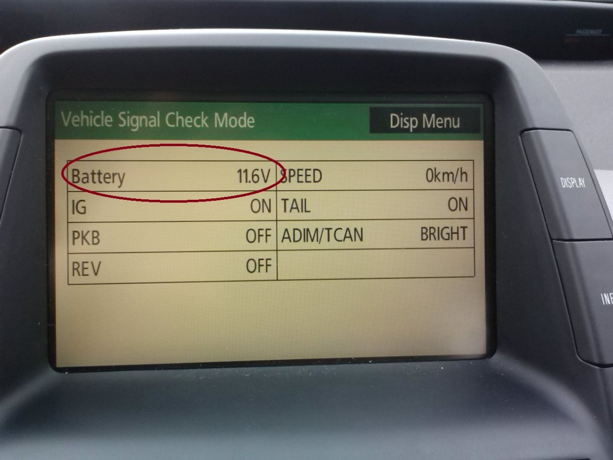 """Pressing the """"Power"""" button will put your Prius in """"Accessory"""" mode, placing a small load/drain on the battery. Again, note the voltage."""