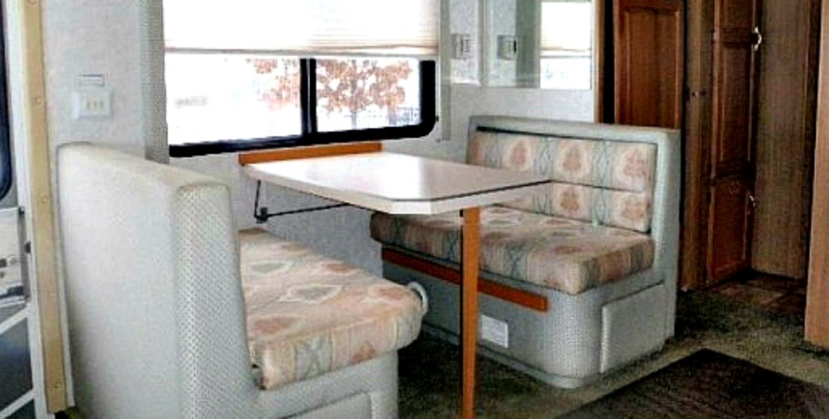 This comfortable eating booth has storage below each seat and can be converted into a bed.