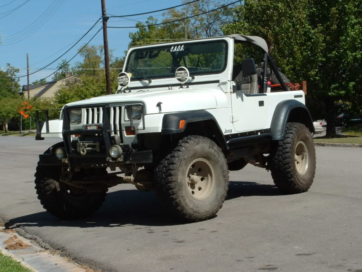 TJ flares on a YJ is a cheap way to gain clearance for bigger tires.