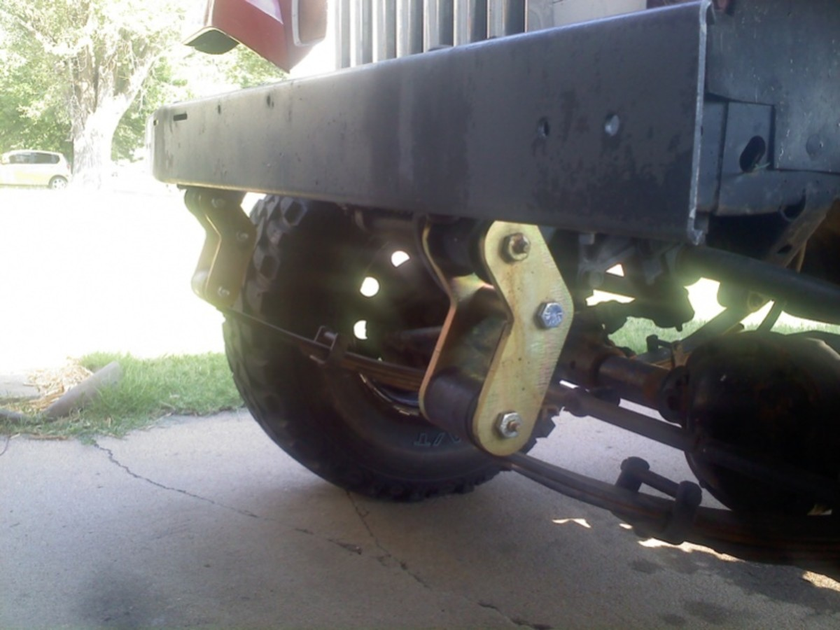 A Jeep with boomerang shackles on the front.