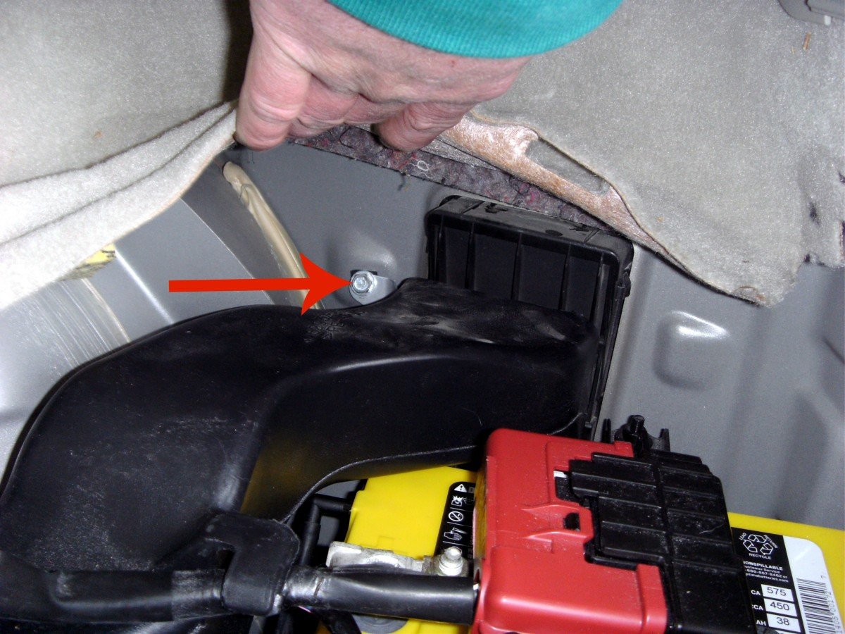 Bolt holding the square cooling vent in place.  Remove this one and one nearer the center of the trunk and work the vent free