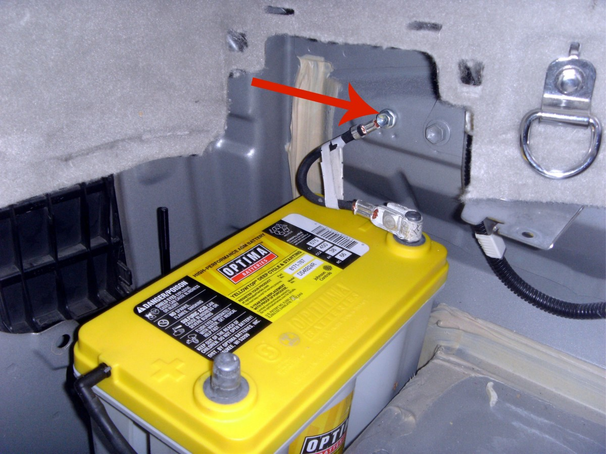 Bolt location of the negative terminal wire.  It's easier to remove this bolt than the terminal itself while still in the car.