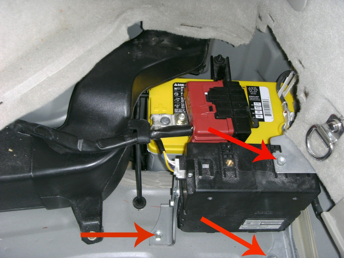 Arrows show the three bolts holding the brake controller in place.
