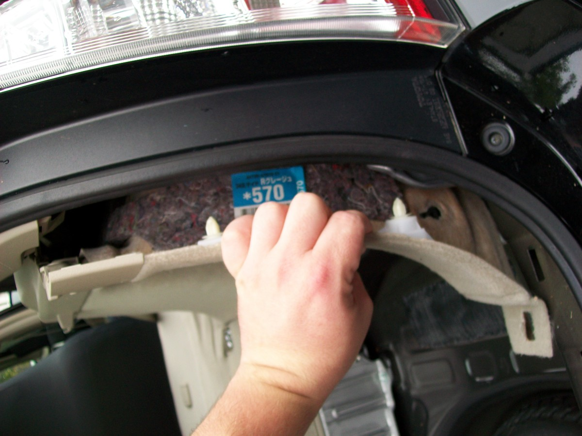 Pull the right rear trim out, it is held in place with upholstery push pins.