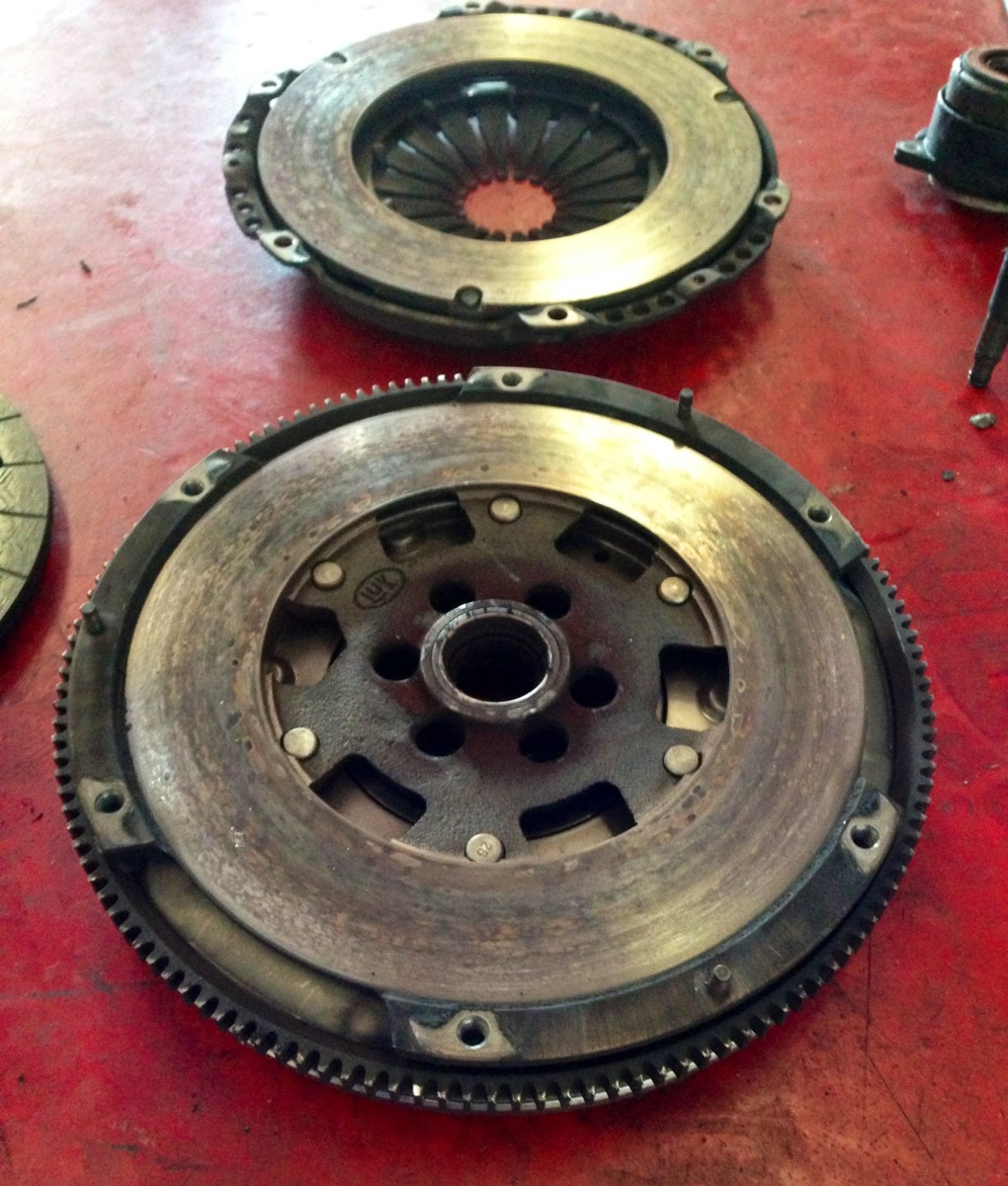 """This 13-year-old Dual Mass Flywheel had 133,000 miles too (but was laid to rest when replacing an original clutch).  Erratic idles, audible """"rattling,"""" and knocking when pressing or lifting the gas pedal can indicate a worn DMF."""