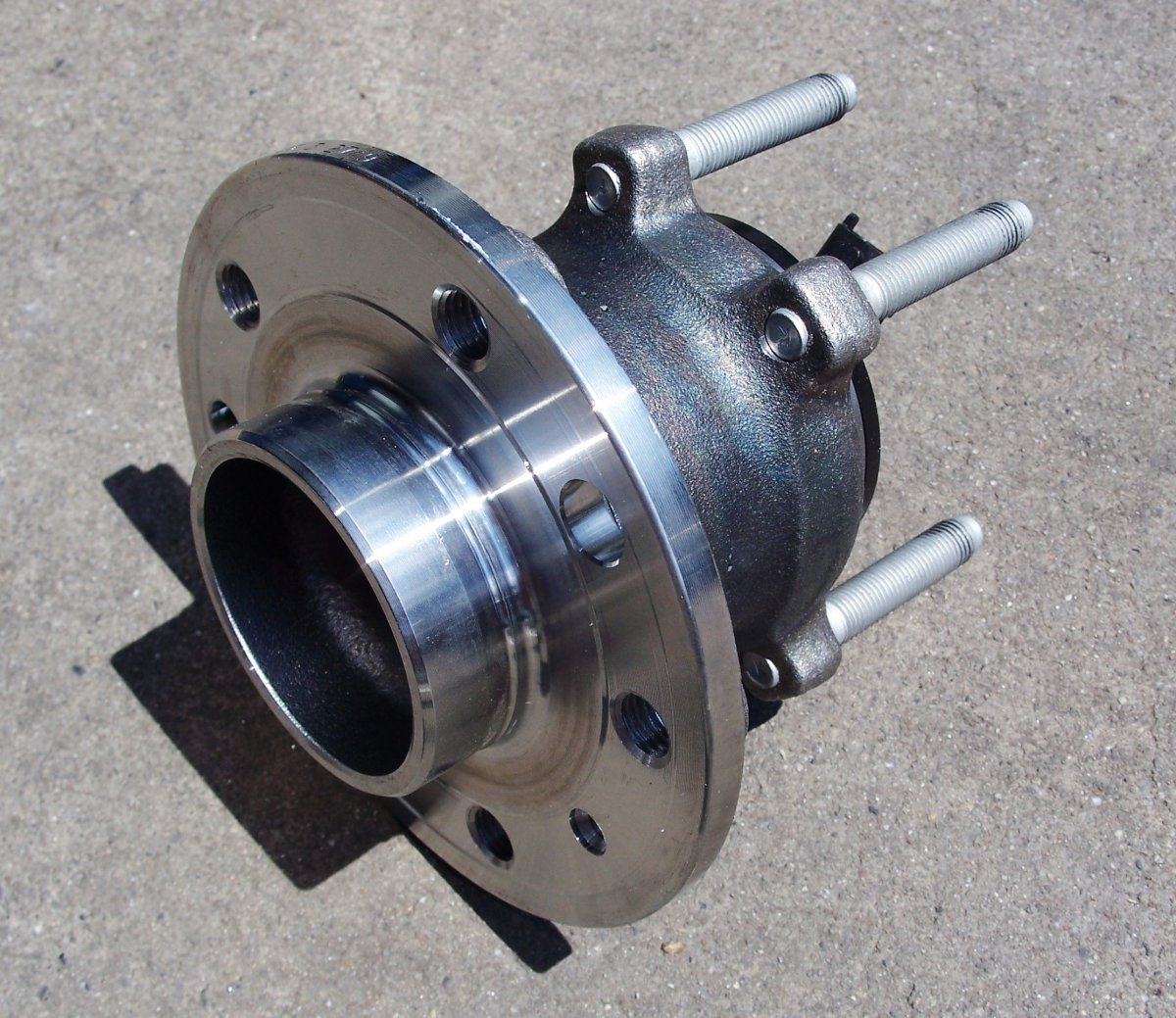 The wheel bearing is pressed into a hub.