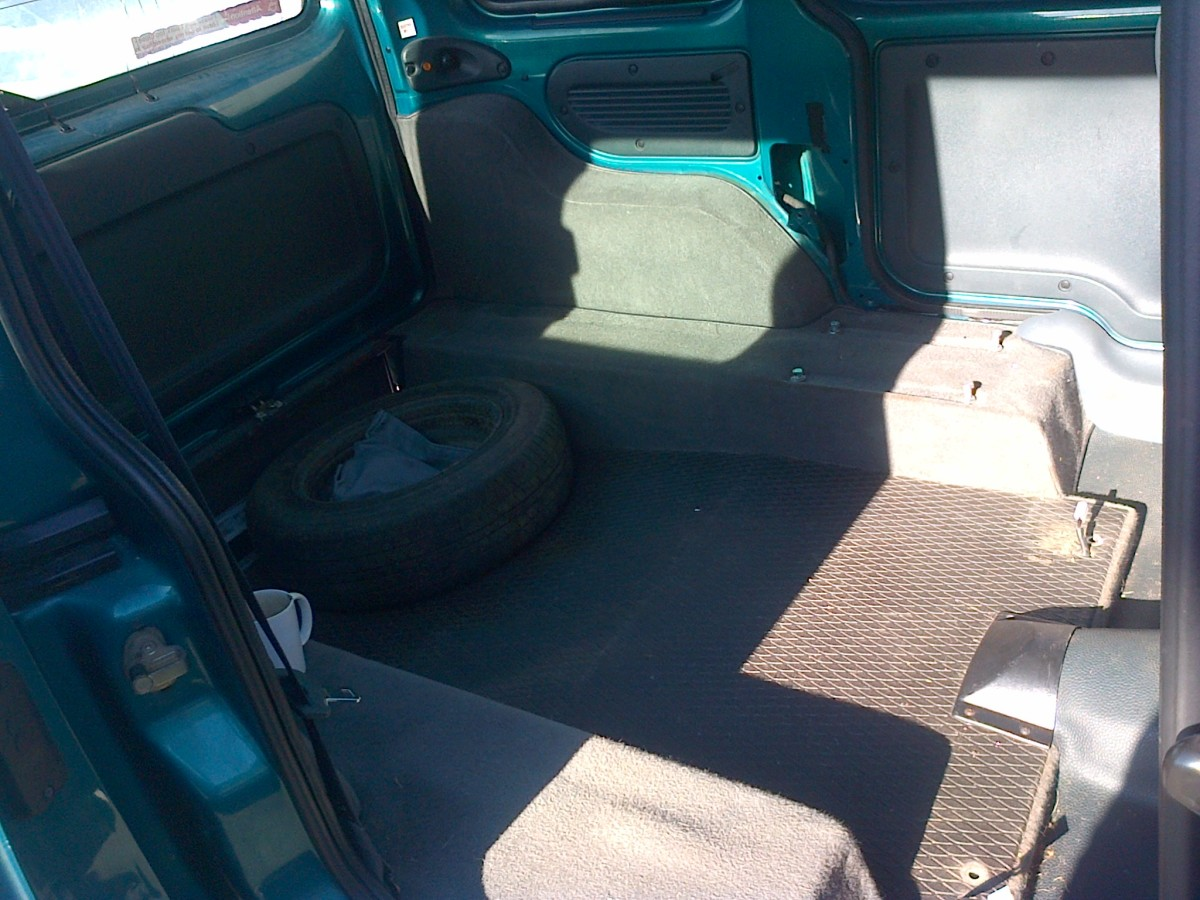 Pull out the back seats and trim.