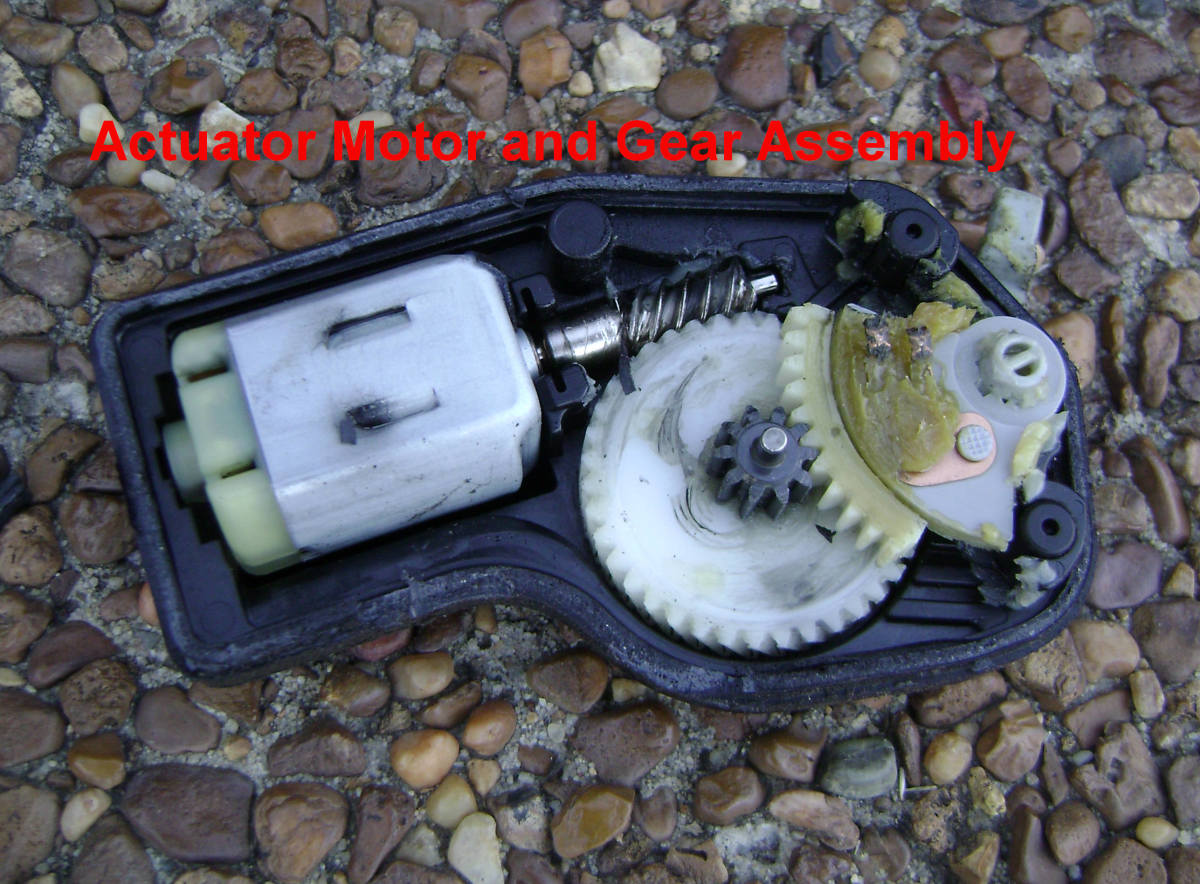 Toyota Camry door lock actuator with cover open