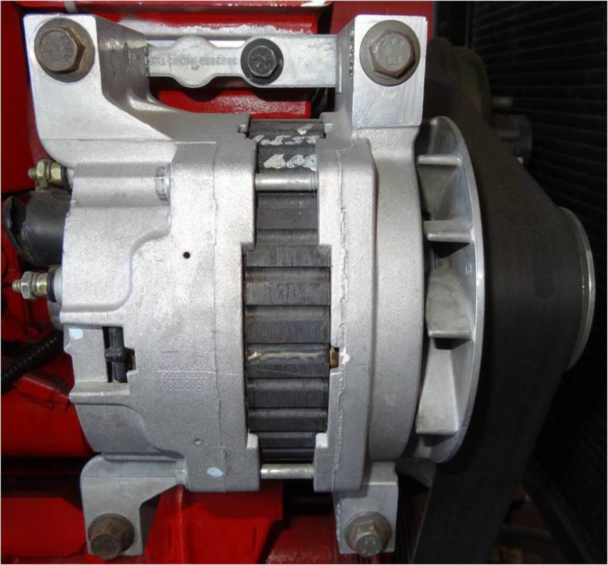 Most alternators today are solidly mounted and are driven with a serpentine belt.