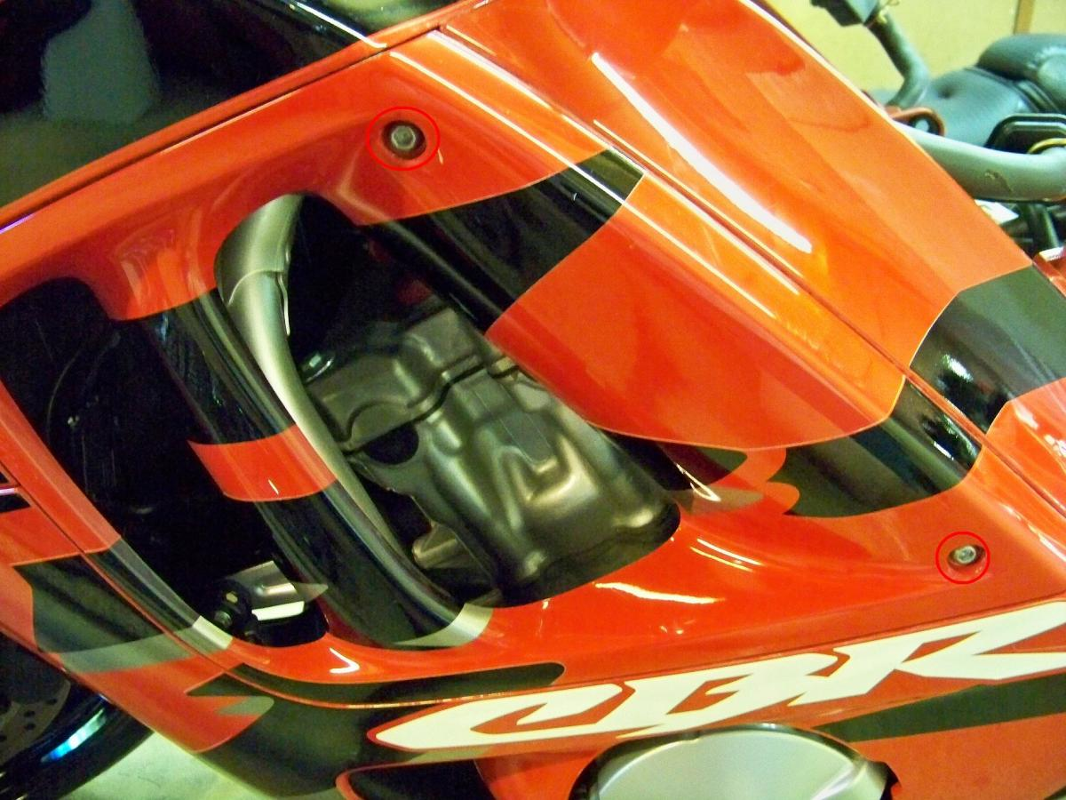 Remove side covers from both sides of bike, they are held in place by two hex head bolts (circled in red).