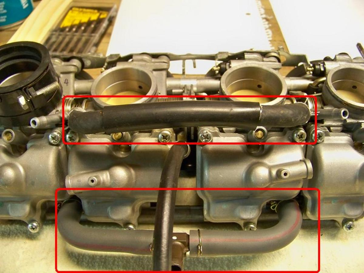 Remove hoses (circled in red)