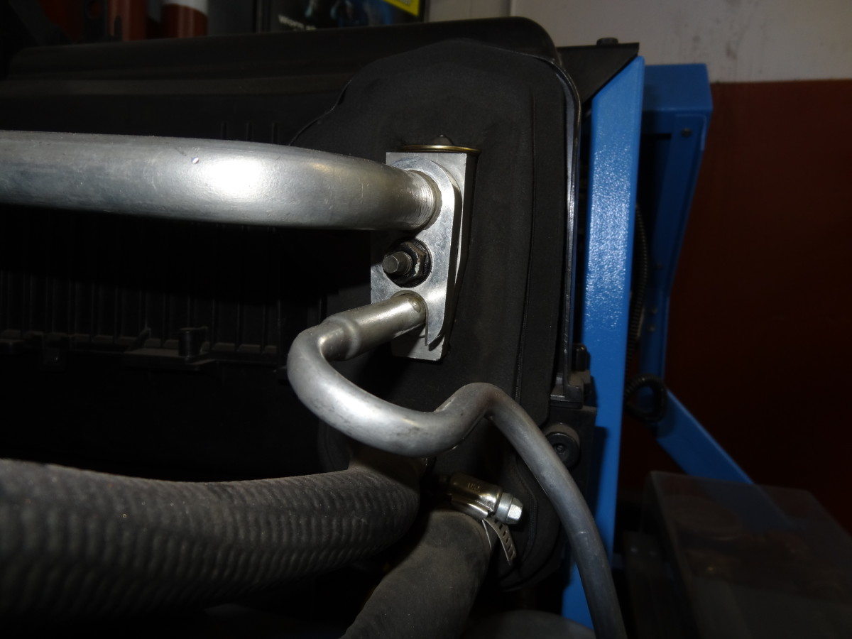 The H-Block is mounted (bolted) on the Evaporator Inlet/Outlet. The Low and High Side Lines connect to the H-Block.