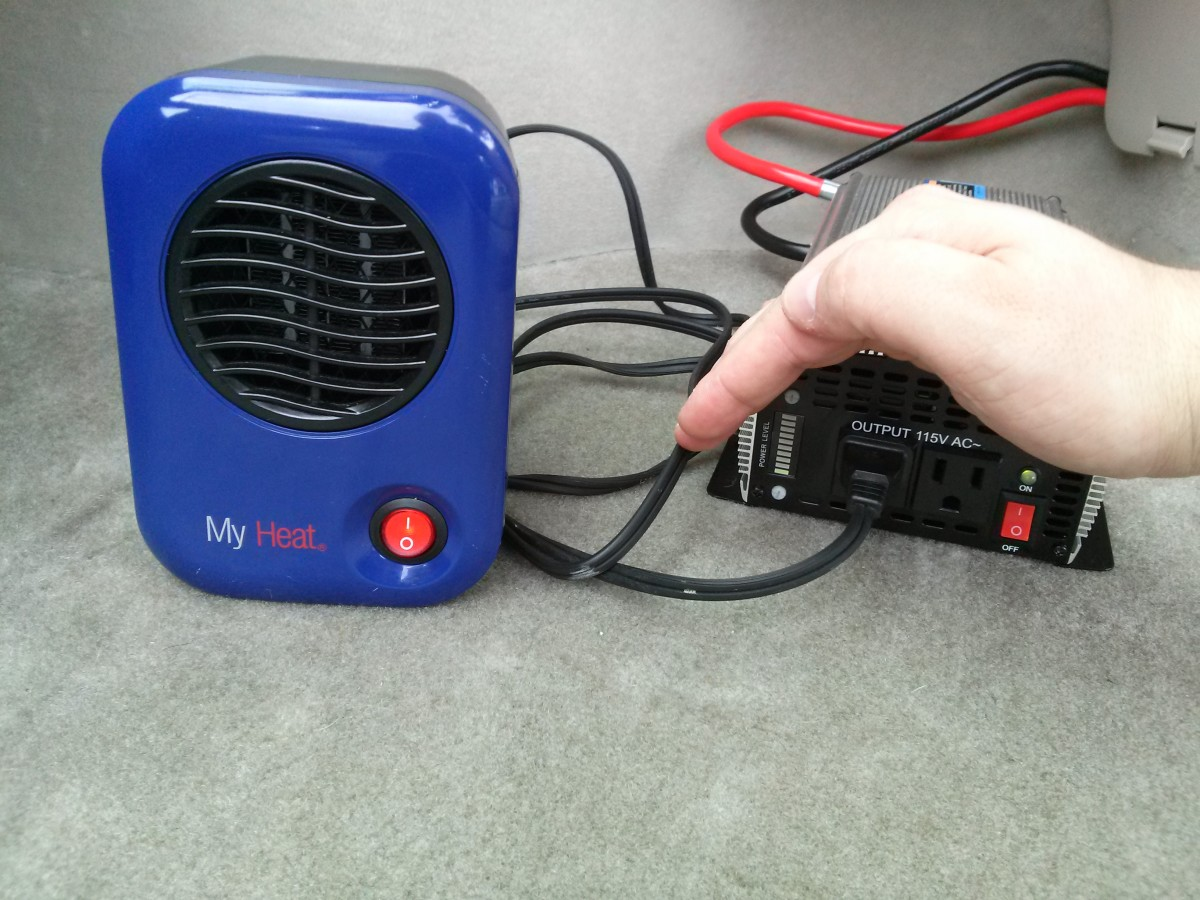 """Heater and inverter both turned on and allowed to stabilize for 1 minute.  It's hard to see in this photo, but the inverter has a """"power level"""" indicator, which has the bottom-most LED lit up with the heater on. Each LED appears to equal 120 watts."""