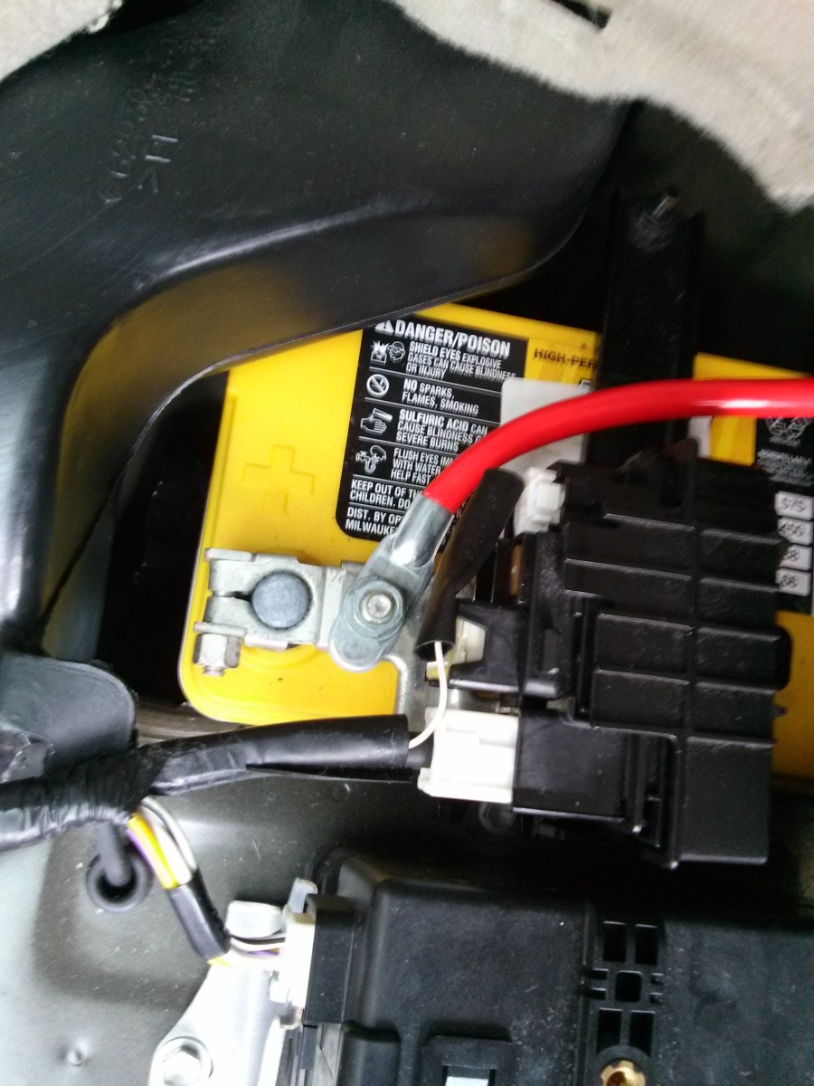 Remove the bolt beside the positive terminal clamp, attach the positive power cable and tighten the bolt on top of it.