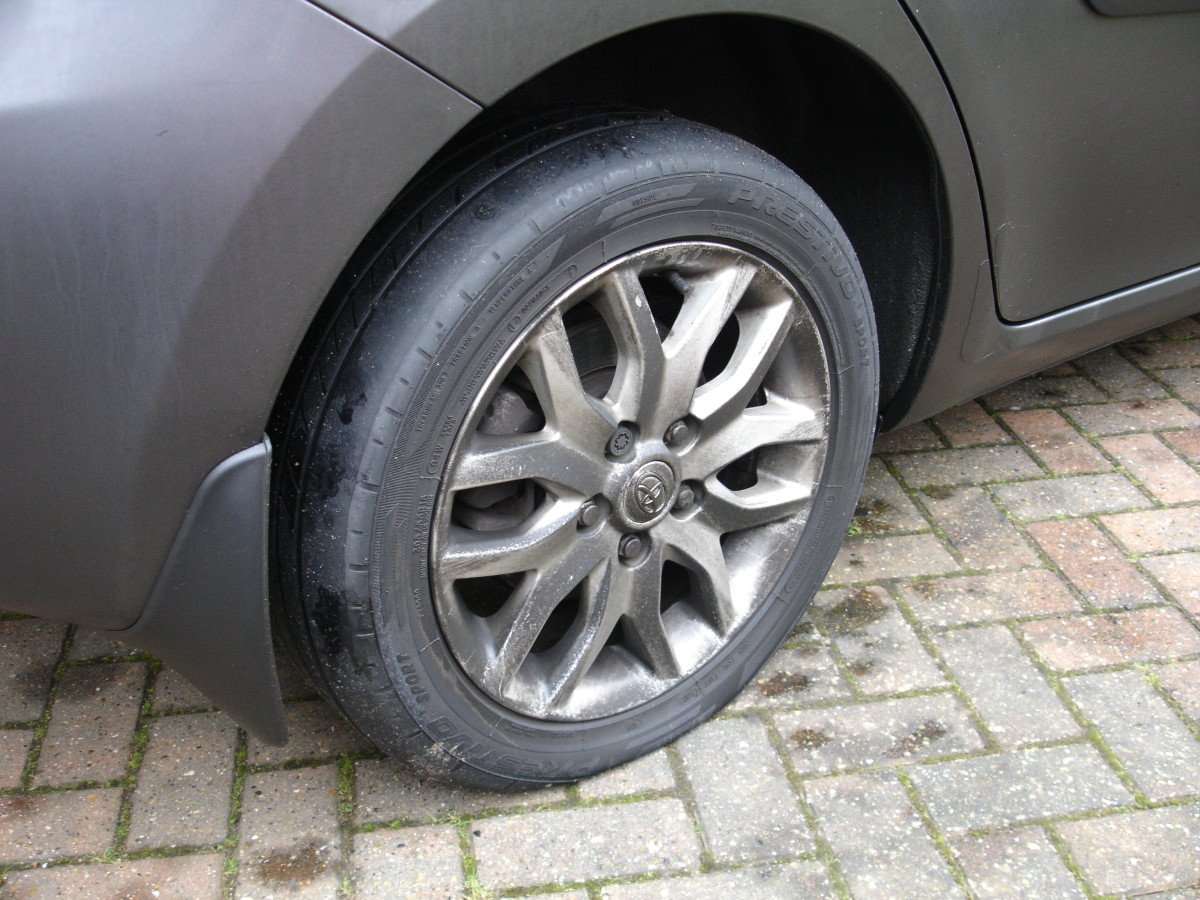 Yep - that tyre is definitely flat.  Bother it.