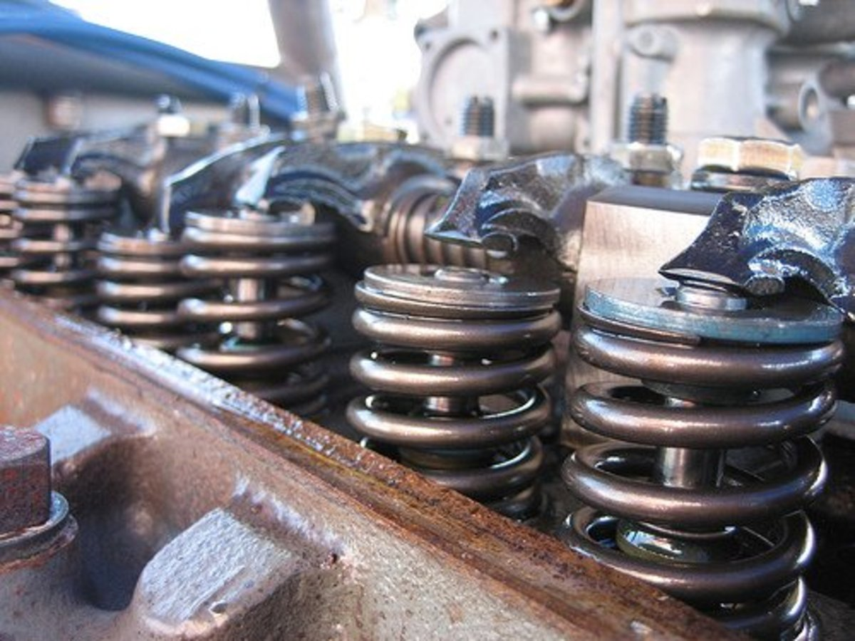 The camshaft controls the opening and closing of the intake and exhaust valves.