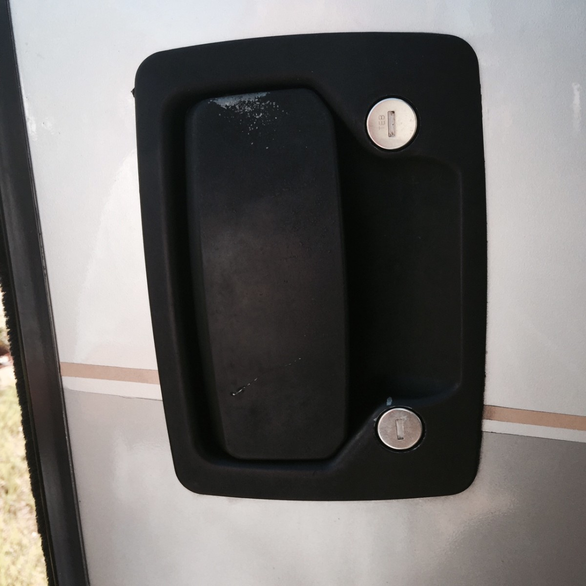 The handle and lock on the door of my RV.