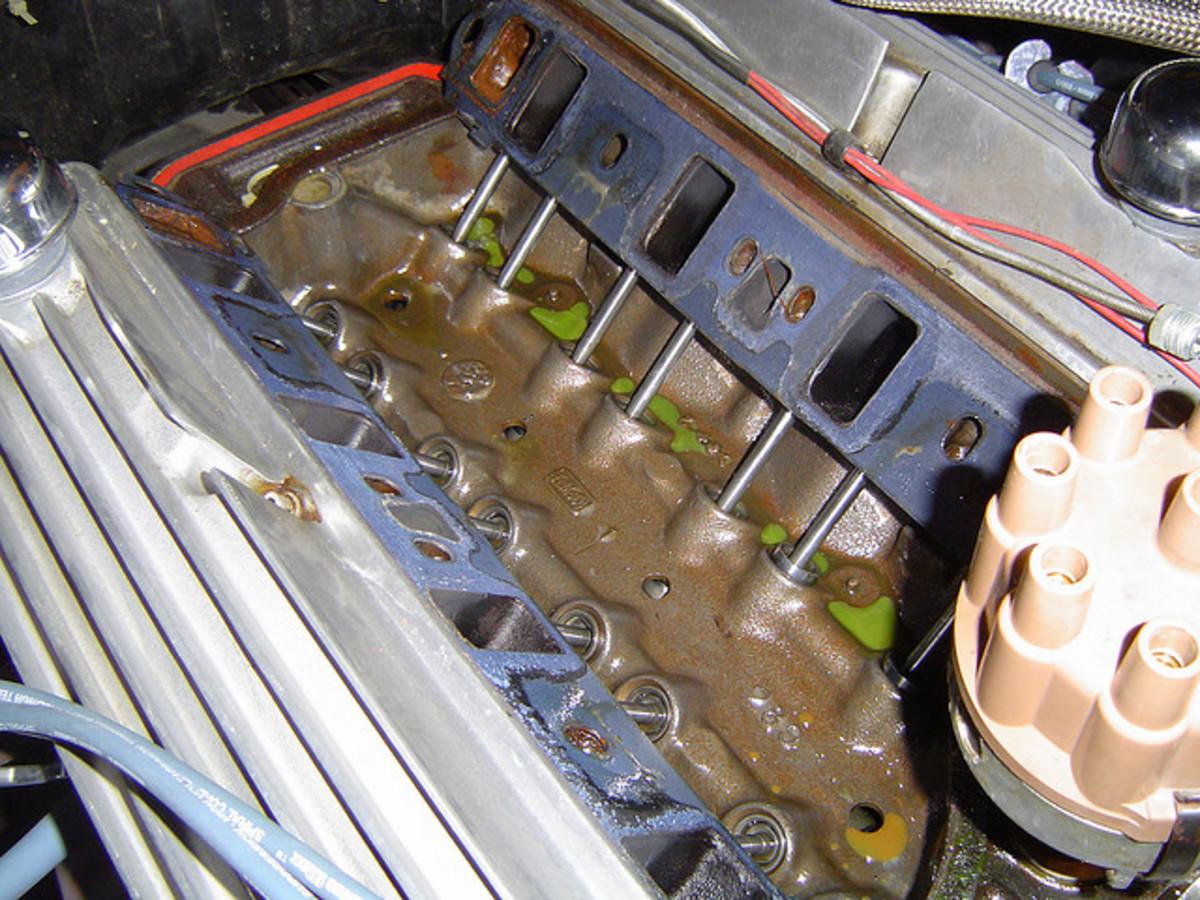 A coolant leak underneath the intake manifold on a V8 engine.