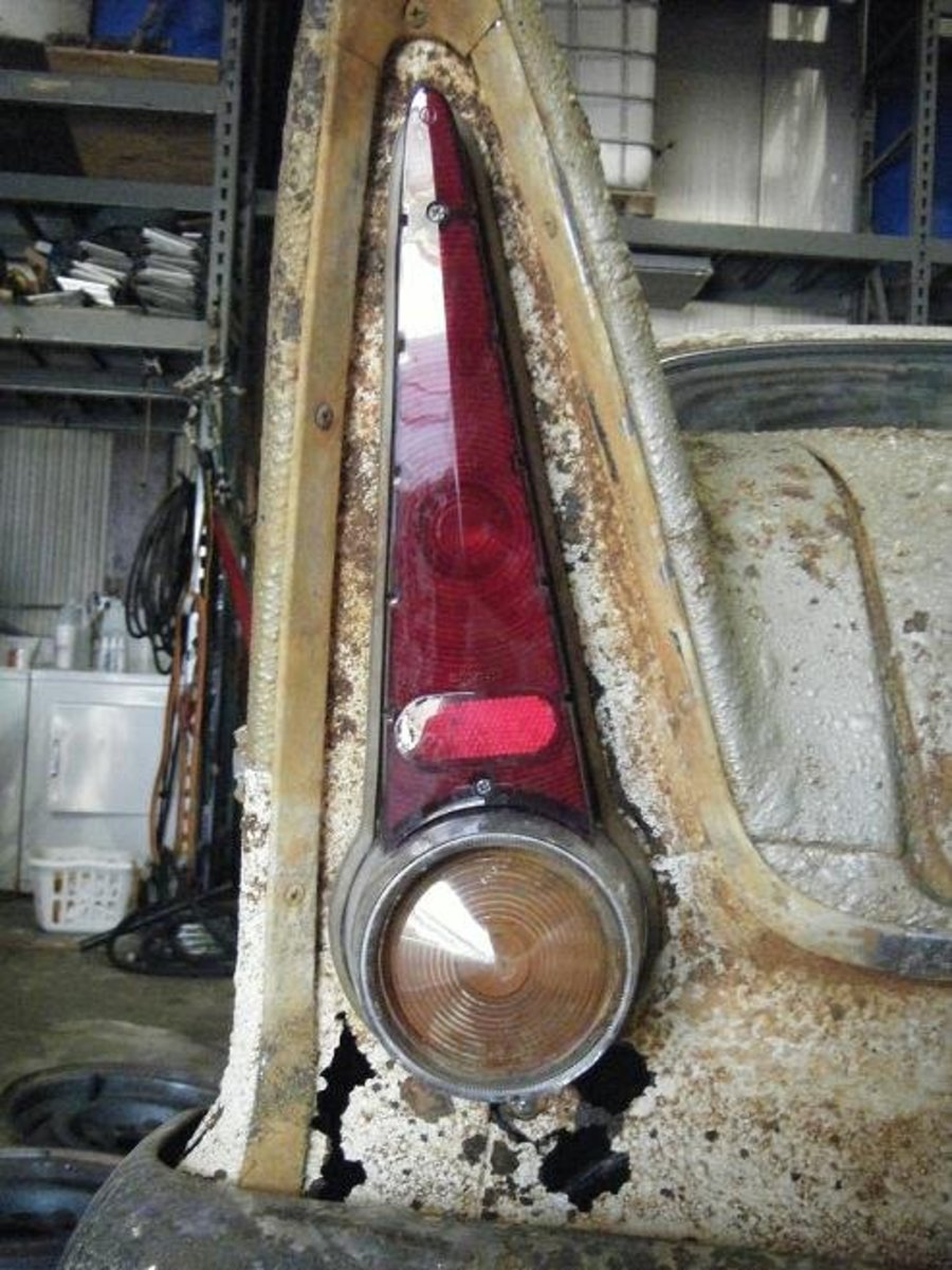 The tail fins show that rust has completely eaten through the sheet metal.