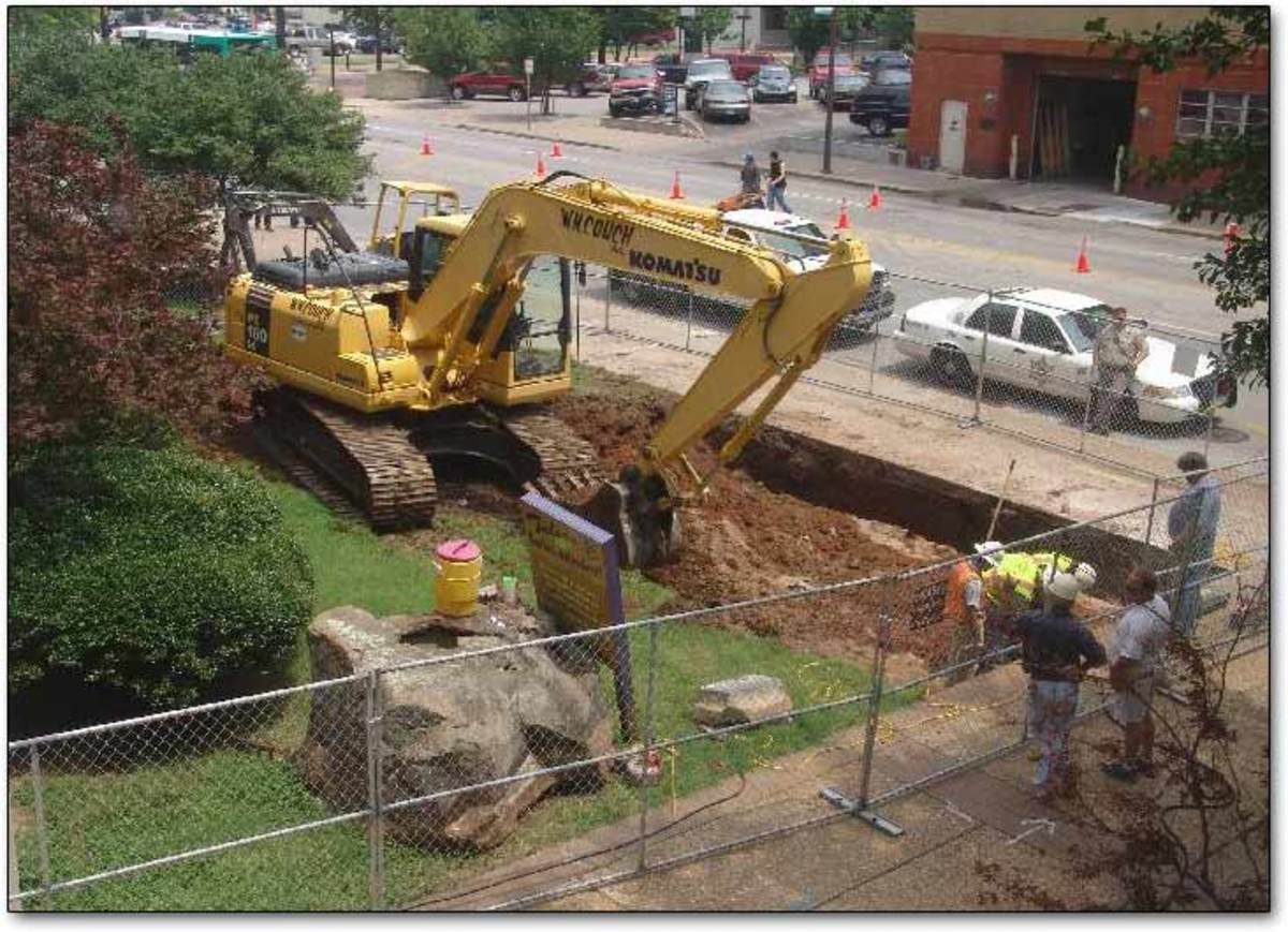 Workers begin excavating the courthouse lawn where Miss Belvedere was buried for 50 years.