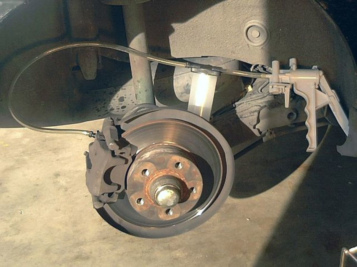 Use a brake bleeding kit to remove air from the brake system.