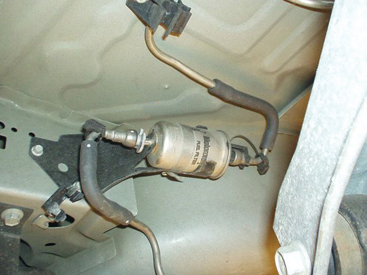 You may find the fuel filter near the fuel tank.